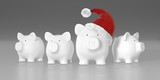 Piggy bank - group with big pig with red santa hat