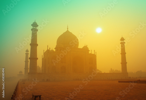 Taj Mahal at sunrise in fog
