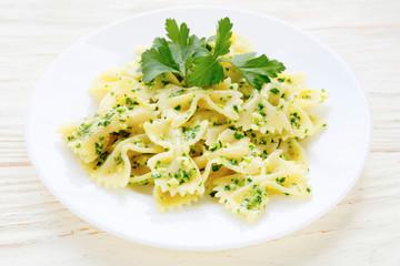 pasta with pesto on white plate