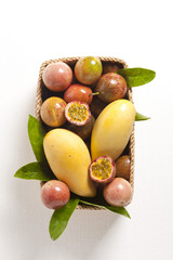Mango with Passion fruit on wood basket