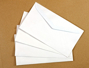 Envelope on brown paper background