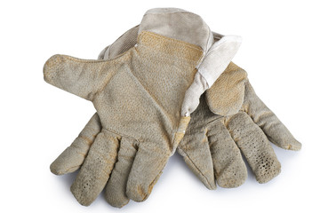 Dirty and well-worn pair of canvas and leather work gloves on wh
