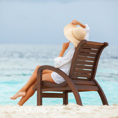 Pretty woman relaxing on the beach