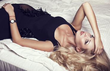 Beautiful girl with blond hair in black dress
