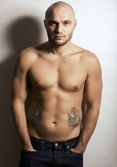 sportive men with tattoo