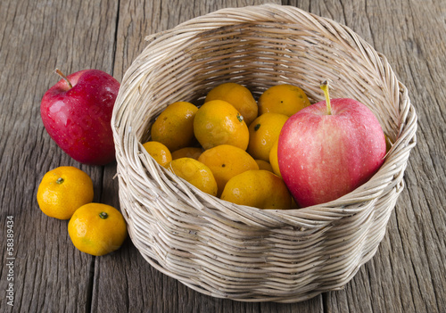 Two kinds of fruit in a basket. And outside