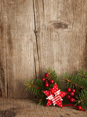 Christmas decoration on wooden plank.
