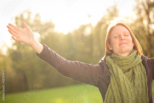 Woman Meditating or Worshiping in Autumn