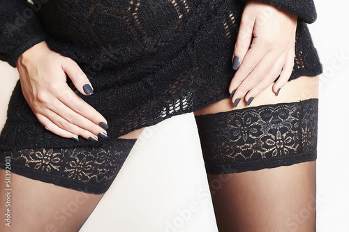 sexy beautiful woman in stockings.black short woolen dress.legs