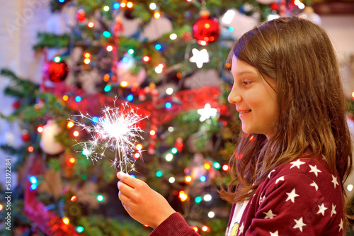 young  girl  holding sparkles