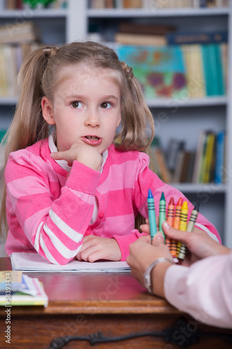 Child chooses the color pencils