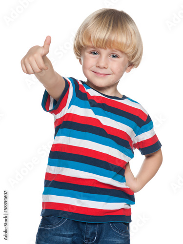 Joyful little boy holding his thumb up
