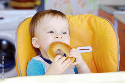 happy baby eating round cracknel
