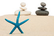 Starfish and the pyramid on the sand