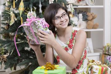 Teenage girl is checking Christmas gift