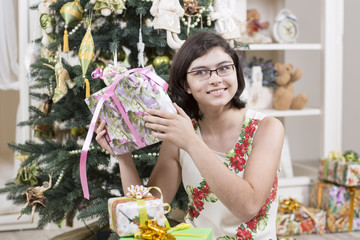 Young woman is intrigued with a gift
