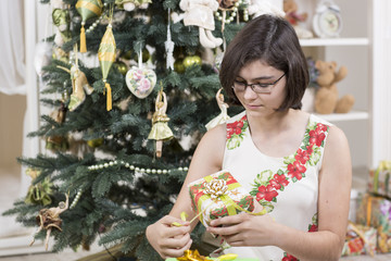 Young girl is opening a gift