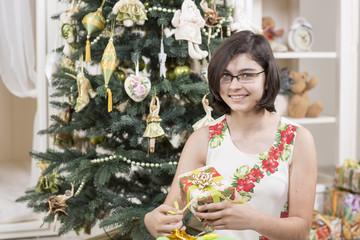 Teenage girl is ready to open Christmas gift