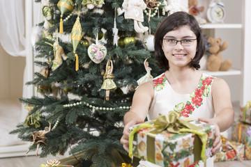 Girl gives Christmas gift
