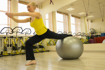 Isometric workout in fitness studio