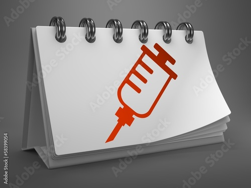 Desktop Calendar with Syringe Icon.