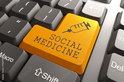 Keyboard with Social Medicine Orange Button.