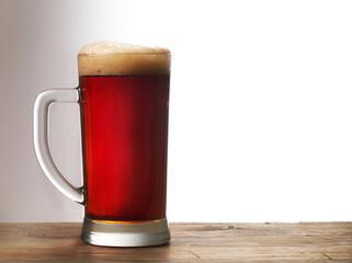 Frosty mug of dark beer