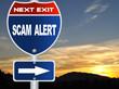 Scam alert road sign