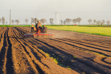Tractor plowing the agricultural field