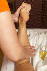 Woman receiving therapeutic massage and lymphatic drainage