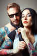 portrait of tattooed man and sexy woman.