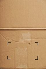 Torn cardboard and symbols