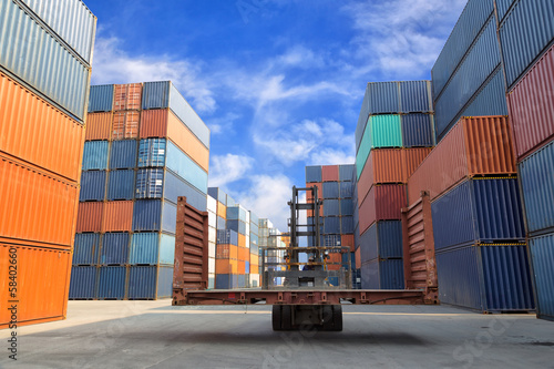 forklift handling the flat rack container box at dockyard