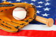 Baseball glove, bat and ball on American flag background