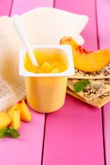 Tasty yogurt with pieces of fresh fruit, cookies