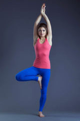 Image of attractive yogi posing in studio