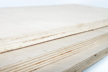 three light plywood boards stacked