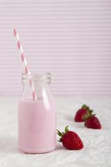 Strawberry milk in retro bottle vertical