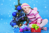 the little girl with the Christmas tree and gifts