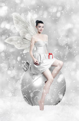 Beautiful young brunette woman as christmas fairy