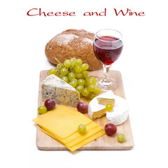 three kinds of cheese, bread, grapes and wine, isolated