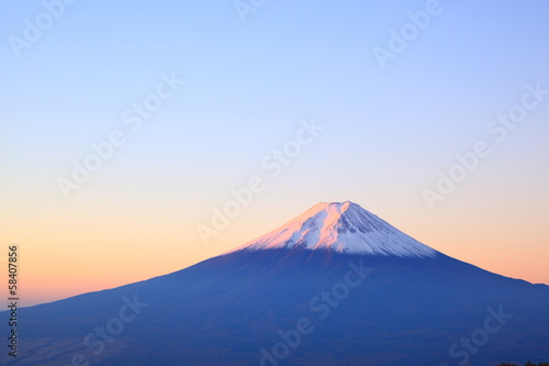 Tuinposter Japan Mt. Fuji glows in the morning sun