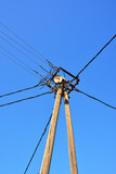old wooden electric pole with many power-lines