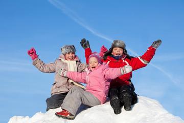 Children against the sky in winter