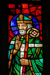 Catholic Saint on stained window in Polish Church