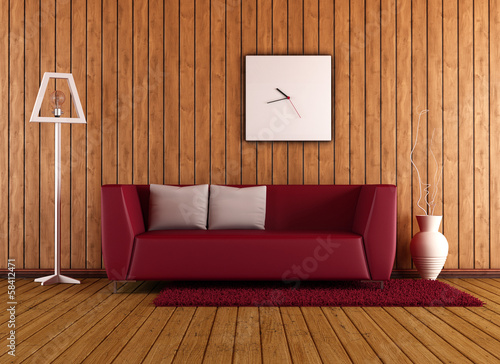 wooden living room with red couch