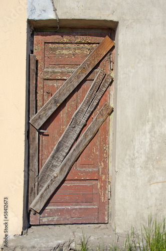 derelict old house closed door