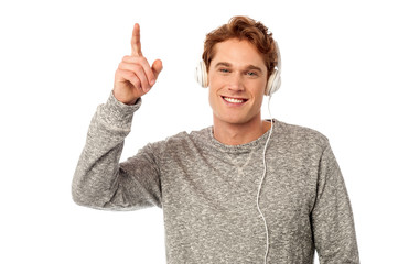 Cool young handsome guy enjoying music