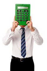 Guy hiding his face behind big calculator