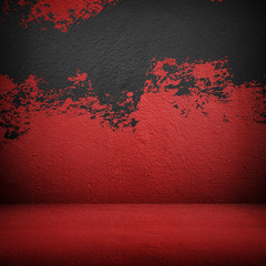 red wall with splash of paint